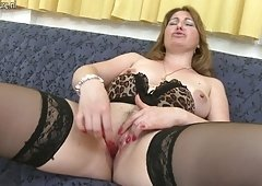 Horny Mama playing with her wet snatch