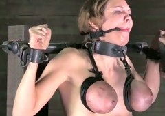 Restrained tattooed brunette hair slut receives her big tits tied up